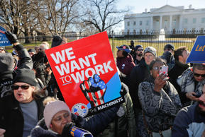 Federal workers, contractors, and supporters demanding the reopening of the gove...