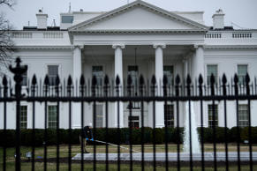 A worker cleans a fountain in front of the White House on the 22nd day of the US...