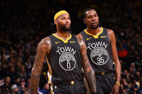 CAPTION: OAKLAND, CA - FEBRUARY 10: Demarcus Cousins #0 and Kevin Durant #35 of ...