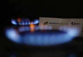 A view of a Southern Electric bill next to some gas rings on a hob, as power com...