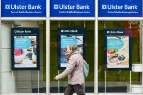 A peson is passing in front of Ulster Bank branch in Dublin's city center. Ulste...