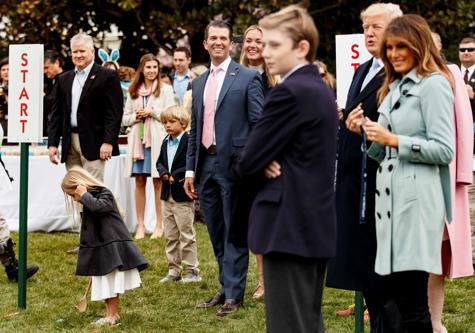 President Donald Trump with first lady Melania Trump and their son Barron Trump,...