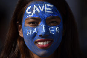 "A Portrait of Nepalese girl decorates her face with the slogan ""SAVE WATER&..."