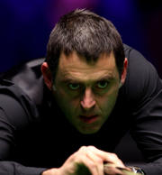 Ronnie O'Sullivan reached the last four in Llandudno after a scrappy contest wit...