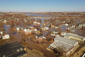 HAMBURG, IOWA - MARCH 20:  Homes and businesses are surrounded by floodwater on ...