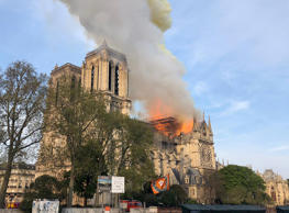 Notre Dame cathedral is burning in Paris, Monday, April 15, 2019. Massive plumes...