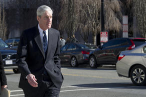 The special counsel, Robert S. Mueller III, and his wife, Ann, walk near the Whi...