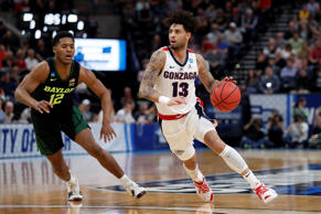 Gonzaga guard Josh Perkins (13) drives to the hoop past Baylor guard Jared Butle...