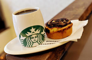 A Starbucks coffee and a Danish pastry at Starbucks, Conduit Street, central Lon...
