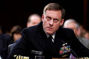 National Security Agency director Adm. Mike Rogers listens during a Senate Intel...