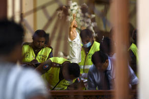 Security personnel inspect inside St. Sebastian's Church in Negombo on April 22.