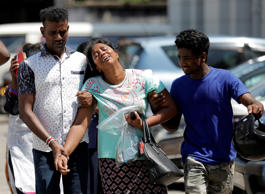 Relatives of victims react at a police mortuary, after bomb blasts ripped throug...
