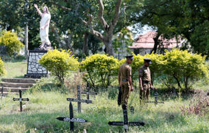 A priest conducts a mass burial for Easter Sunday bomb blast victims in Negombo,...