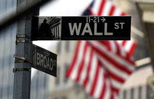 A Wall Street road sign is pictured near the New York Stock Exchange (NYSE) buil...
