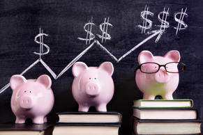 Three pink piggy banks standing on books next to a blackboard with simple saving...