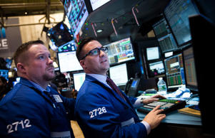 Traders work on the floor of the New York Stock Exchange during the afternoon of...