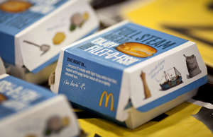 Filet-O-Fish sandwiches sit on a tray at a McDonald's restaurant in Little Falls...