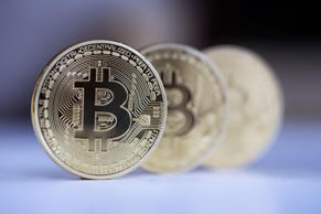 Three Bitcoins stand in this arranged photograph in Danbury, U.K., on Thursday, ...