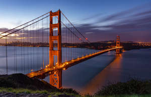 Golden Gate Bridge with a backdrop of San Francisco Skyline during Dawn