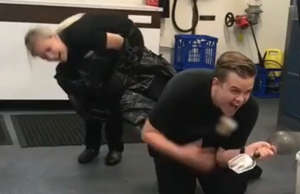 Coworker hides in pile of garbage to pull off hilarious scare prank