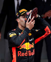 Red Bull's Daniel Ricciardo drinks out of his shoe as he celebrates winning  the .