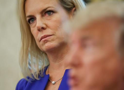 Homeland Security Secretary Kirstjen Nielsen, left, listens to President Donald ...