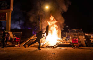 Protesters lit fires and burned buildings in Minneapolis overnight Thursday.
