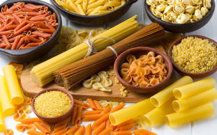 Differents types of pasta on the white wooden table