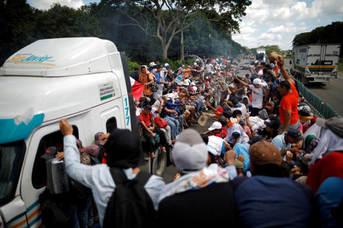 Central American migrants, who are part of a caravan of migrants trying to reach...