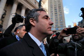 Michael Cohen walks out of federal court, Thursday, Nov. 29, 2018, in New York, ...