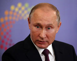 Russian President Vladimir Putin speaks during his press conference at the G20 S...