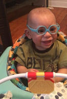 See baby's joyous reaction to wearing glasses for 1st time