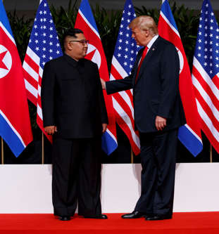 President Donald Trump meets with North Korean leader Kim Jong Un on Sentosa Isl...
