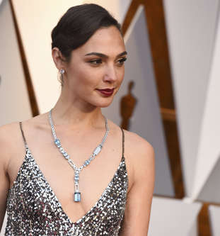 Gal Gadot arrives at the Oscars on Sunday, March 4, 2018, at the Dolby Theatre i...