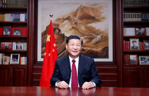 In this photo released by China's Xinhua News Agency, Chinese President Xi Jinpi...